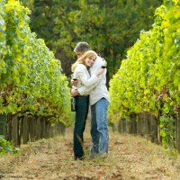 Couple hugging in a vineyard