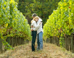 Couple hugging in a vineyard