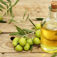 Olives and a bottle of Olive Oil