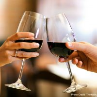 A toast with red wine. Visit Italics Wine to experience delicious red wine